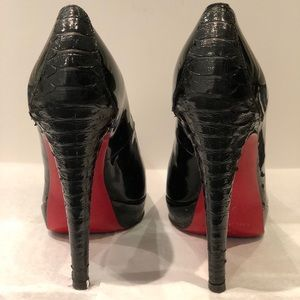 Black patent leather high heels with red soles